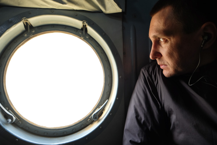 Sergey looking out the helicopter window