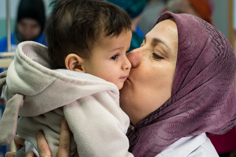 Dr. Naima from Benghazi Medical Center kissing one of the patients