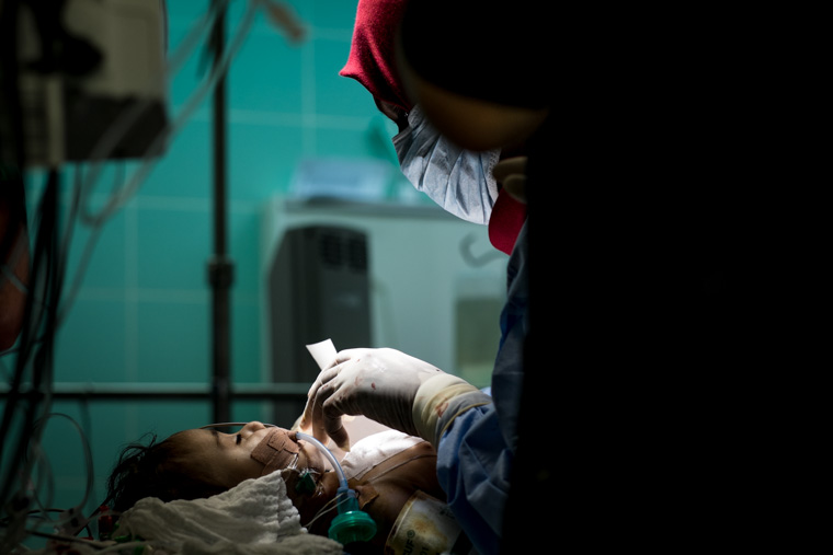 A baby being prepped in the OR